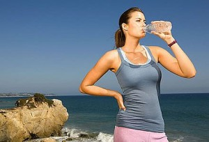 Drink water to stay healthy on vacation
